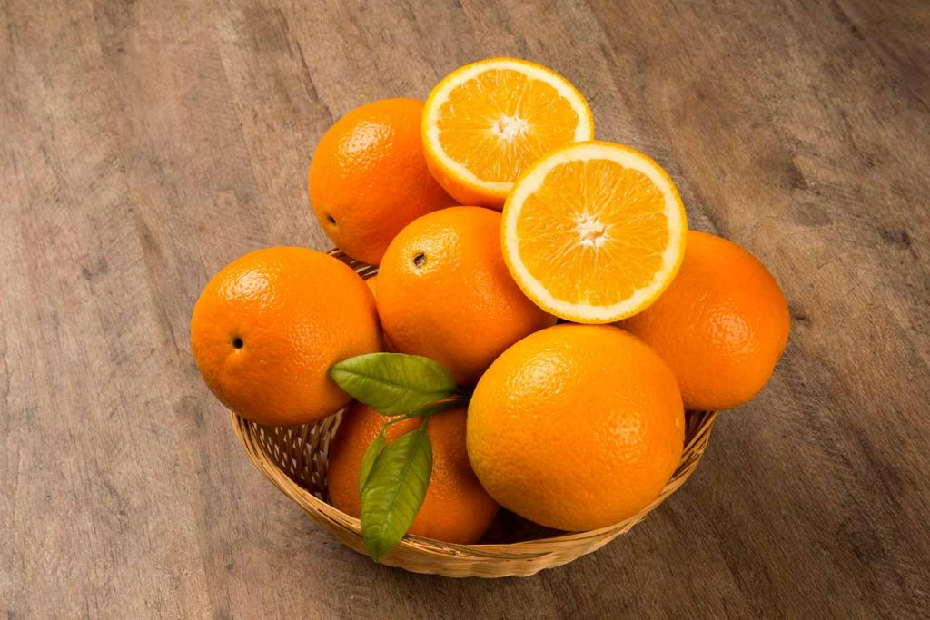 Fresh Organic Oranges by Organic Mountain